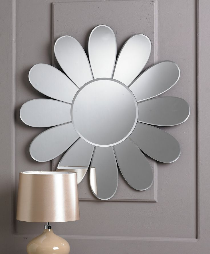 This is a charming light hearted round mirror, basically a small circle surrounded by a dozen large petal like bevelled glass pieces, giving the overall impression of a daisy. It would look great in any contemporary living space.