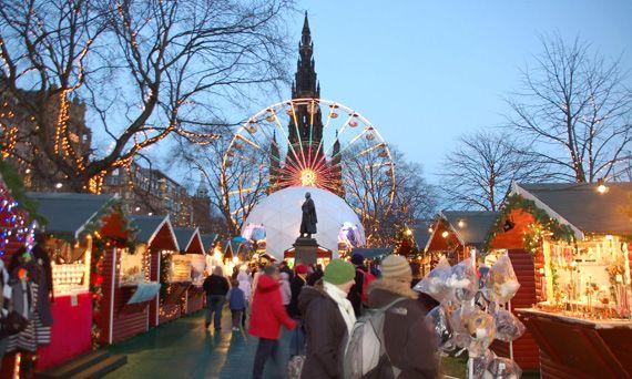 Shoppers peruse the Christmas market stalls at =The Christmas market in Princes Street Gardens, Edinburgh. via @VisitScotland