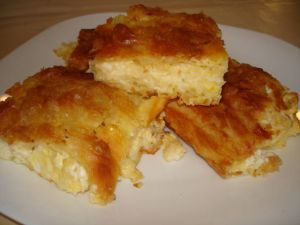 Τεμπέλικη Τυρόπιτα (χωρίς φύλλο)Γρήγορη και νόστιμη.. Υλικά 2 κεσεδάκια γιαούρτι (των 200 γραμμαρίων) 250 γραμμάρια μαργαρίνη ή βούτυρο 5 αβγά 1/2 κιλό τυρί φέτα 1/2 κιλό διάφορα τριμμένα τυριά 1 φλιτζάνι φαρίναπ λίγο πιπέρι και ρίγανη ή δυόσμο Loading... Οδηγίες Ανακατεύουμε καλά όλα τα υλικά μαζί σε ένα μπωλ. Βουτυρώνουμε ένα ταψί, απλώνουμε ομοιόμορφα το …