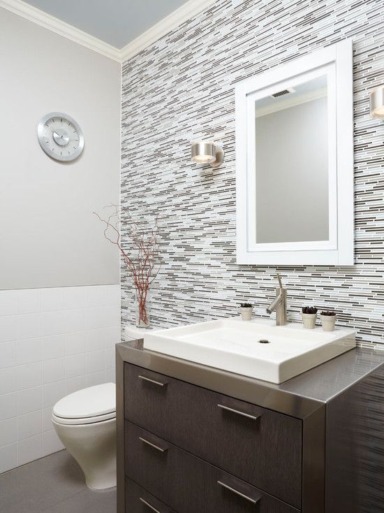 The Gray Over Tone With Full Wall Back Splash Of Tile And Dark Vanity