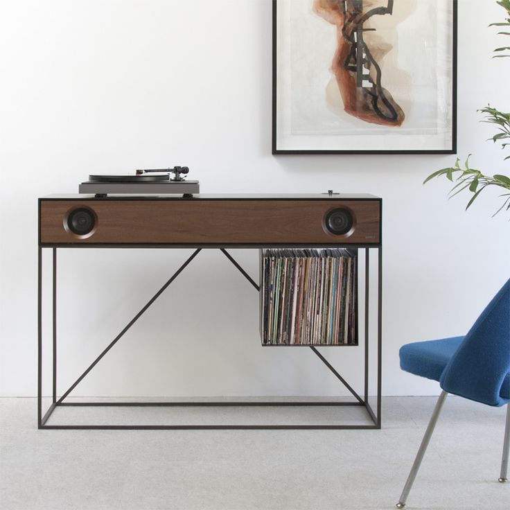 Designed for the aesthete vinyl lover, a handmade modern console equipped with a built-in 2.1 stereo system, a turntable, and cable/cord management.