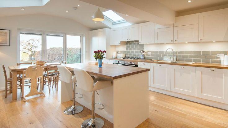 white shaker kitchen wooden worktops with island