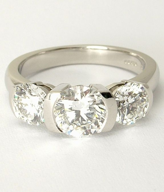 New This bespoke diamond trio reveal ring is handcrafted in platinum u is designed to allow light
