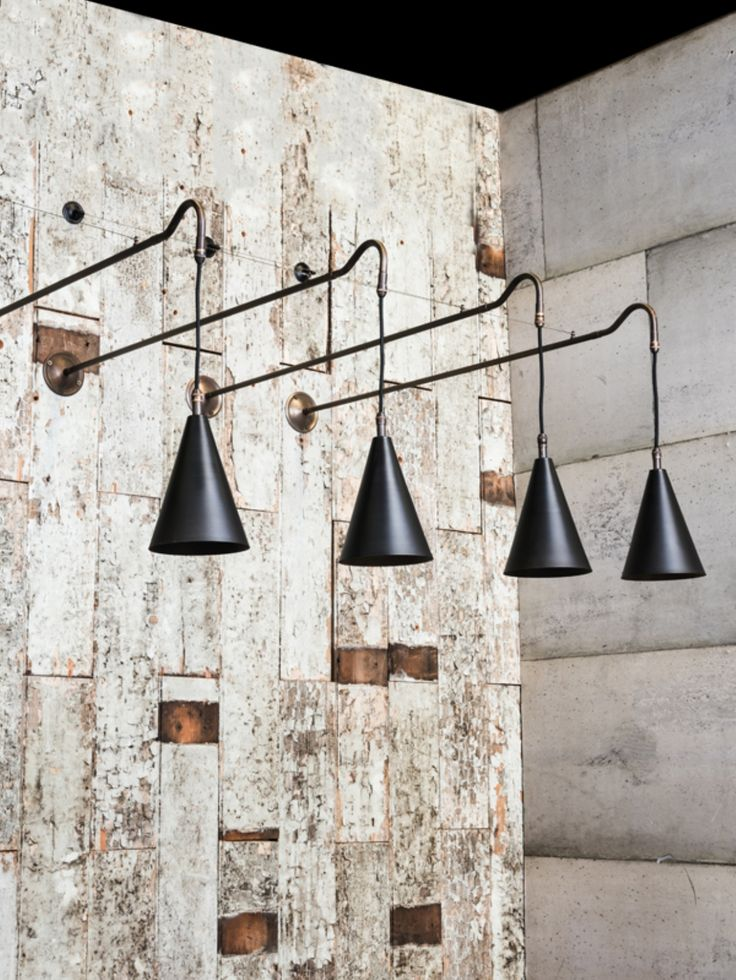 Brass wall light with hanging braided cable drop and filament lamps. Perfect for…