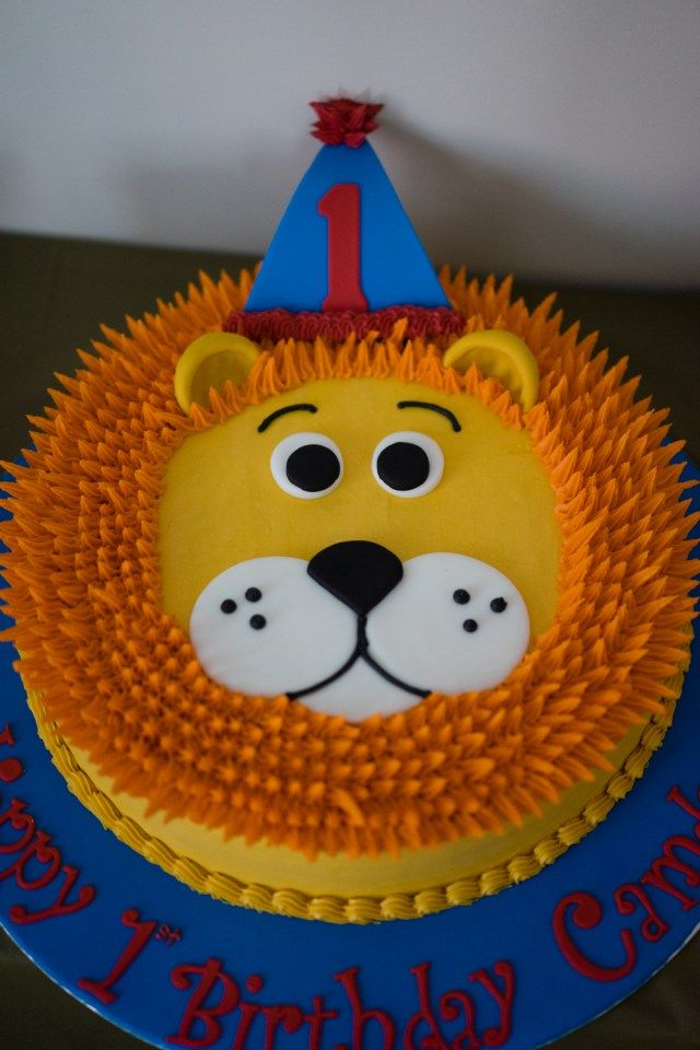 "A lion first birthday party which included a lion cake and ""Wild One"" theme."