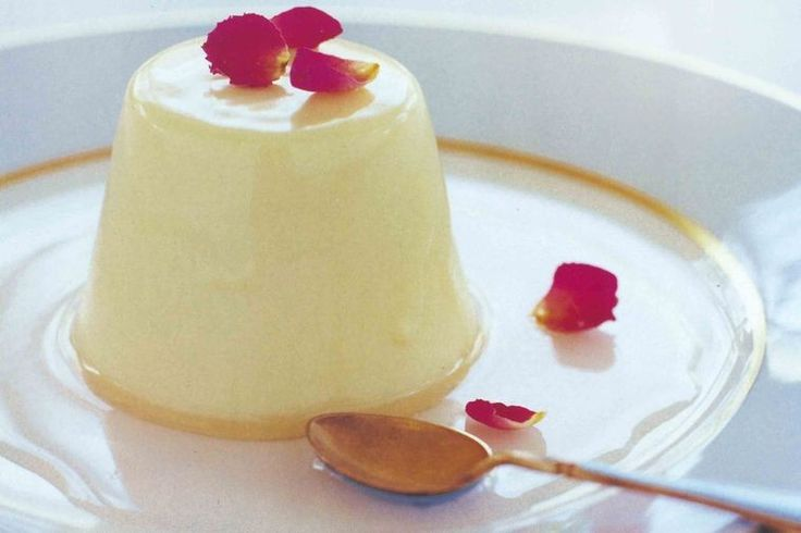 This irresistible white chocolate panna cotta is finished off with a luscious sticky syrup made from rosewater.