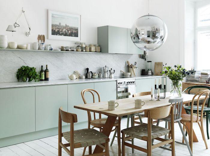 Emma Persson Lagerberg's beautiful mint green kitchen. Photo by Petra Bindel for Elle Interiör, via Remodelista.
