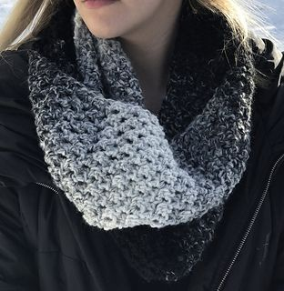 This scarf is made of simple rows of single little solomon's knots, which makes it light and lofty but also with great texture (the 'knots')… perfect for a Bulky weight yarn like the Lion Brand Scarfie used here.
