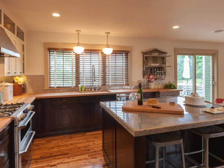An open kitchen layout with no peninsula was the preferred option of online voters. The reverse-raised Shaker cabinet style, too, was selected by fans of Blog Cabin 2012.