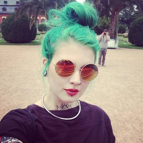 Green All Over Color styled into. High bun .