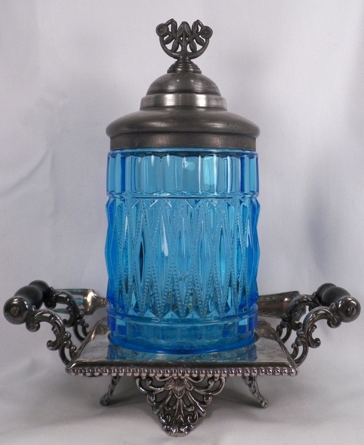 Antique blue pickle castor.  Gorgeous blue color. Interesting though... it seems to be a tray.  And I see no tongs.  I wonder if this really is a pickle castor.