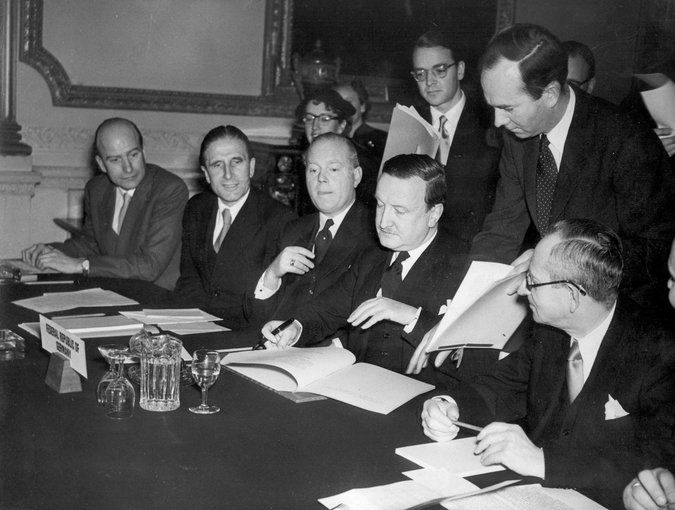 In 1953, Hermann Josef Abs, center, signed an agreement that effectively cut West Germany's post-World War II debt in half. Credit Associated Press