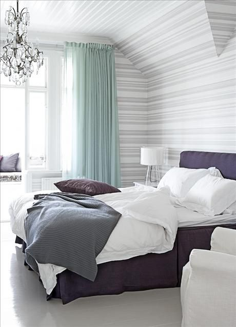 Purple, grey and teal accent colours in the bedroom. Coloured sheers are different.
