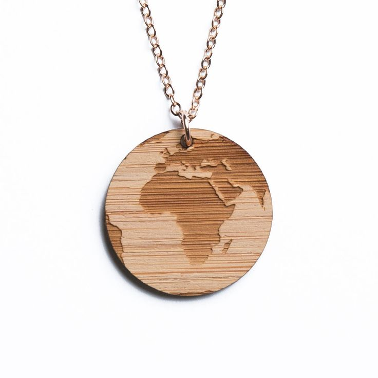 Africa map necklace, etched into eco-friendly FSC certified bamboo (using a laser burner), on a recycled rose gold plated sterling silver chain.