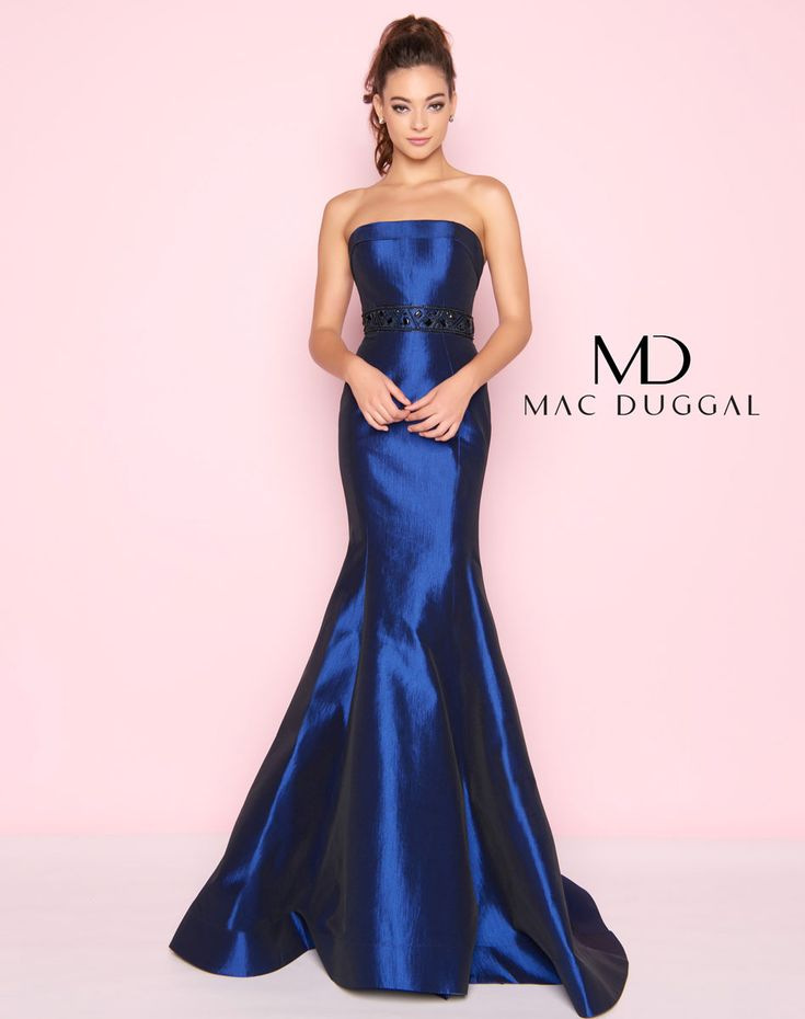 Strapless stretch taffeta gown adorned with beading at the waist accented with a trumpet skirt.