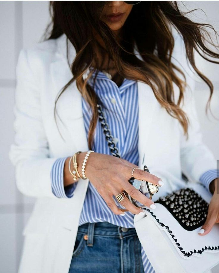 Spring elegance with white blazer, striped shirt and denim jeans.