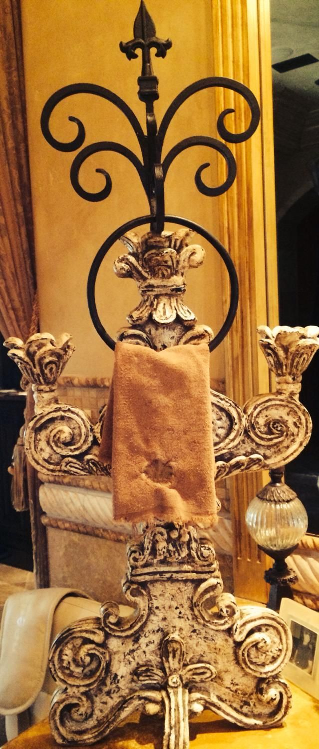 Old-World-Tuscan Bathroom Idea: metal decorating details like this Rebecca Justice towel holder.