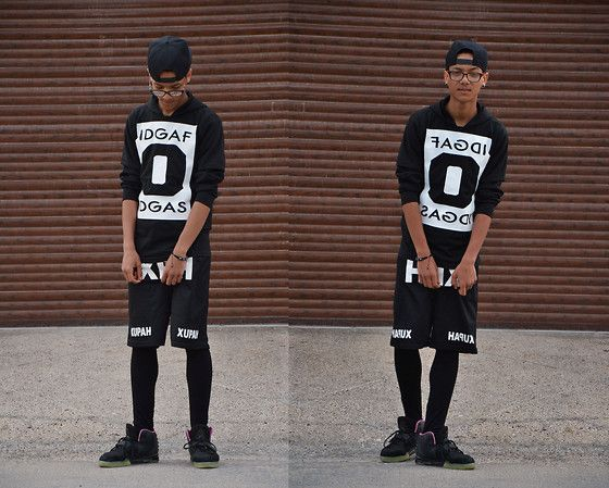 Shop this look on Lookastic:  http://lookastic.com/men/looks/black-baseball-cap-and-black-and-white-hoodie-and-black-high-top-sneakers-and-black-and-white-shorts/2797  — Black Baseball Cap  — Black and White Print Hoodie  — Black Suede High Top Sneakers  — Black and White Shorts