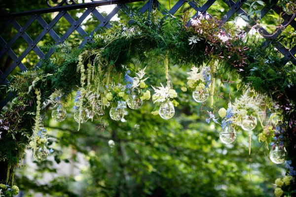 Garden insetting with hanging florals and glass