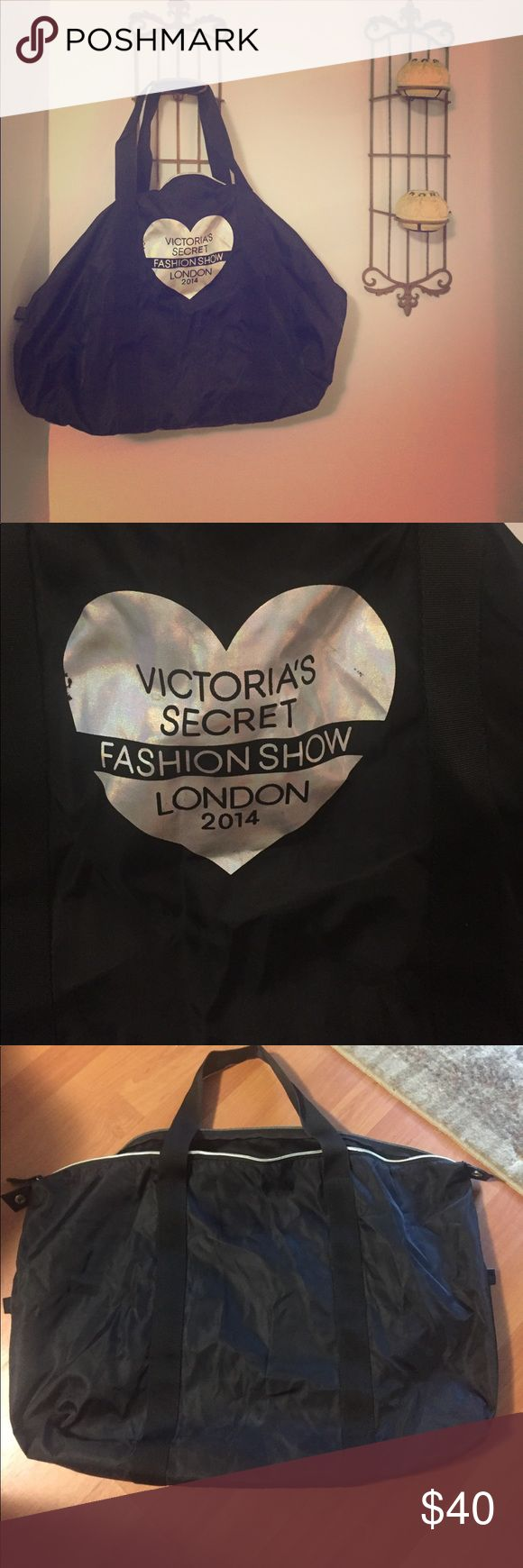 """VS Fashion Show bag 🌻 """"Victoria's Secret Fashion Show / London 2014"""" bag. Large. Black. One big zipper compartment. Small scratch on silver heart (pictured), otherwise perfect condition. Victoria's Secret Bags"""