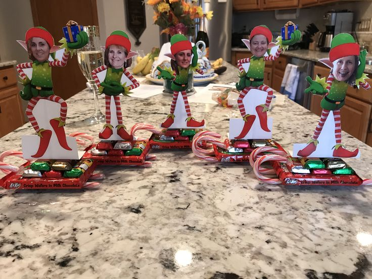 Christmas elf seating cards with candy sleigh.