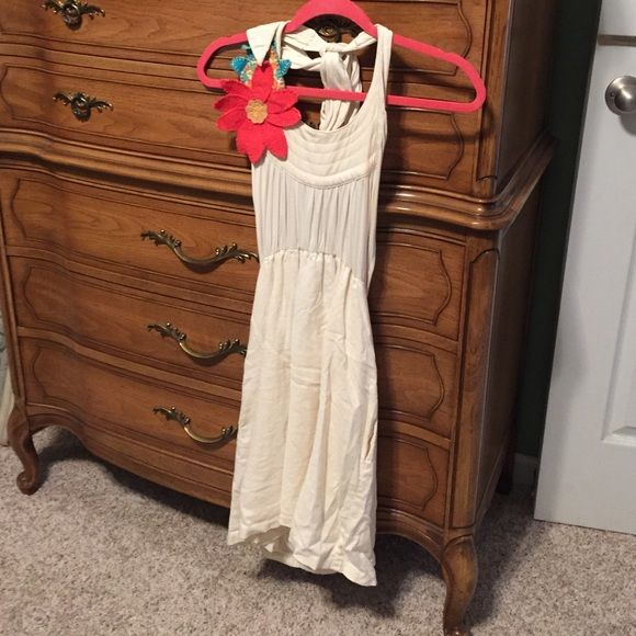 Large Judith March halter dress Like new Judith March ivory halter dress with flower detail. This is everything you love about Judith March! Size large and worn once. Large. Judith March Dresses