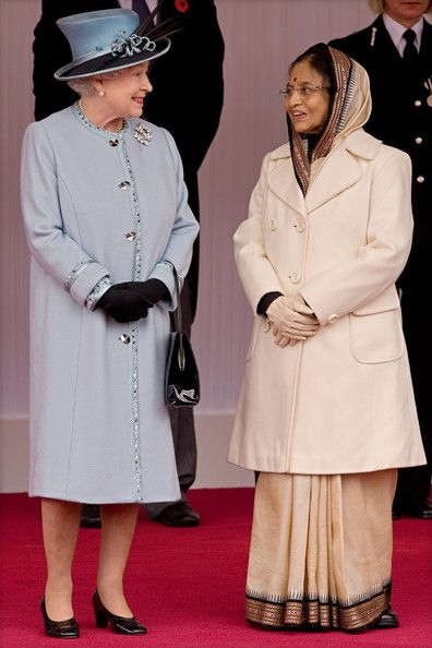 The President of the Republic of India Pratibha Patil (R) is greeted by Britain's Queen Elizabeth II,as she arrives in Windsor at the beginning of a State Visit to to Britain on October 27, 2009, in Windsor, England. Patil, the first Indian woman elected to the ceremonial role, was taken on a state carriage procession to Windsor Castle, where she will stay during the trip and where she received a Guard of Honour.