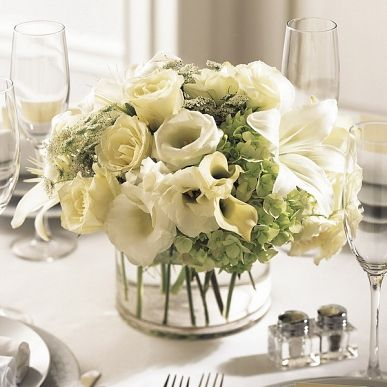 Wedding Centrepiece with Soft Colours. Find it at http://www.lebouquet.com/the-ftd-white-linen-centerpiece