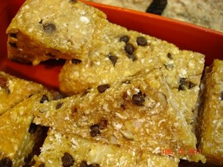 Homemade Protein Bars: 7 Scoops Vanilla protein powder, 2 c quick oats, 5 T sliced almonds, 1/4 c mini choc chips, 3 T honey, 3 T natural Peanut Butter, add water to good consistency. Mix & Press into sprayed baking dish. Bake at 350 for approx 15 min.