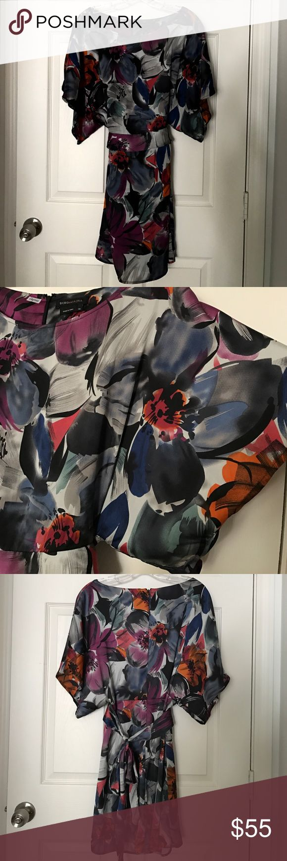 BCBGMaxAzria floral dress BCBGMaxAzria floral dress. Gorgeous piece! Full kimono sleeves, tie waistband & full skirt. Flowers looked hand painted, lots of strokes & colors. Colorful but lined with grays & blacks so doesn't look too bright. BCBGMaxAzria Dresses