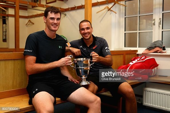 LONDON, ENGLAND - JUNE 25: Jamie Murray of Great Britain and Bruno Soares of Brazil celebrate victory in the locker room following the mens doubles final against Julien Benneteau of France and Edourd Roger-Vasselin of France during day seven of the 2017 Aegon Championships at Queens Club on June 25, 2017 in London, England. (Photo by Clive Brunskill/Getty Images)