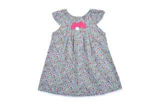 Vestido para bebe niña con diseño de florecitas lilas, fucsia y verdes. Escote redondo y sin mangas.