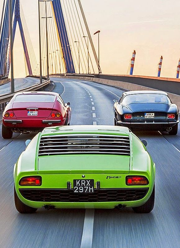 Iso Grifo (Right), Ferrari 365 GTB/4 Daytona (Left), Lamborghini Miura (Center)
