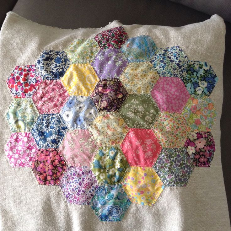 Hexagons of fabrics purchased in Liberty in London and stitched onto linen to make into a cushion or...