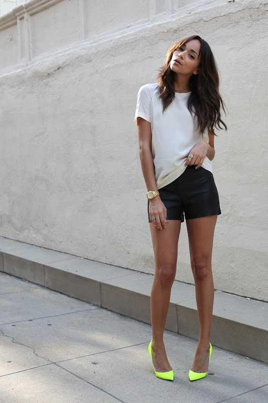 black shorts white tee neon heels