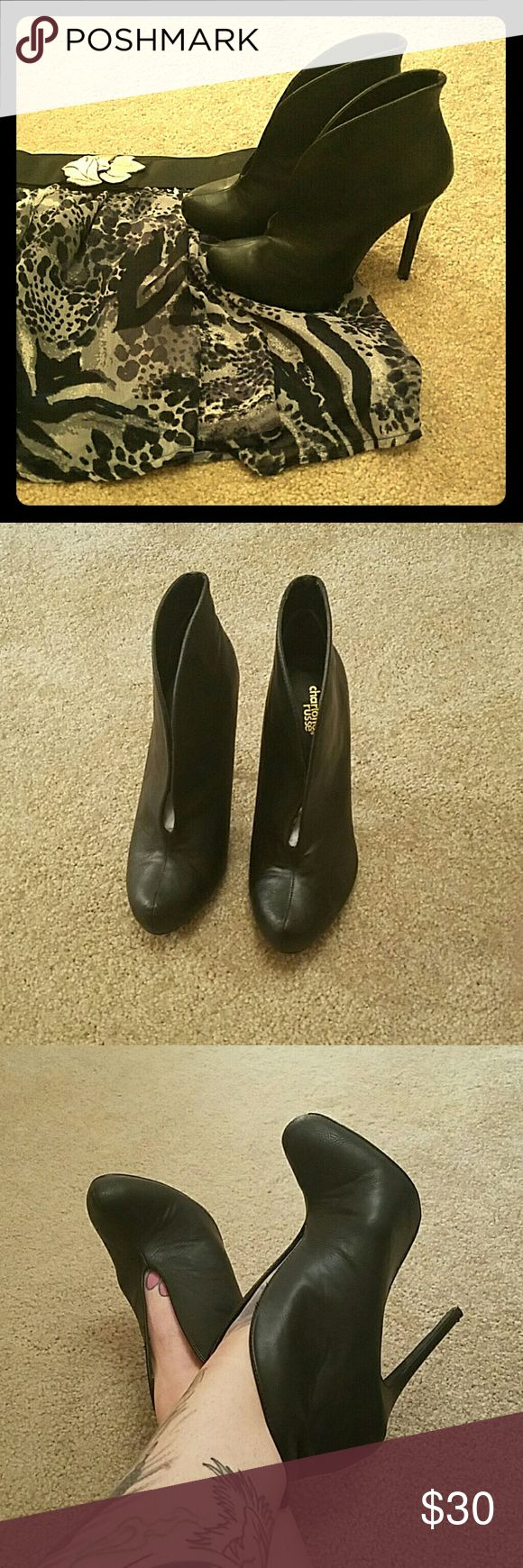 Charlotte Russe Deep V Sexy Black Booties In perfect condition!! Charlotte Russe brand deep V skillet over booties. Super slimming effect on legs, great with pants or skirts. Worn once for about an hour. Charlotte Russe Shoes Heeled Boots