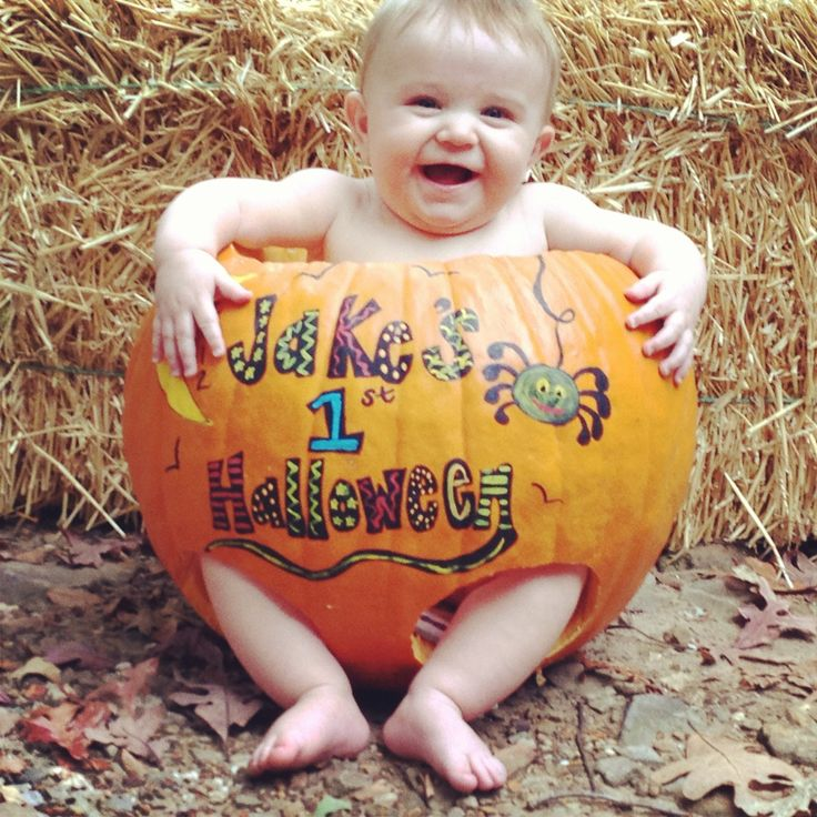 My baby boys first Halloween:) It will need to be a BIG pumpkin for my chubby guy to fit lol