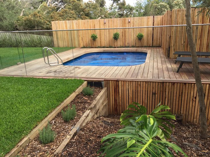 Above Ground Pool With Over Hanging Spotted Gum Deck And Curved Spotted Gum Coping To Hide The Deck Constru Decks Around Pools Pool Landscaping Building A Deck