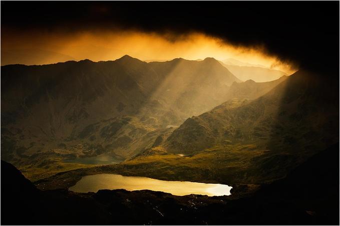 Bucura Lake, situated in the Retezat Mountains, in Romania. Beautiful light