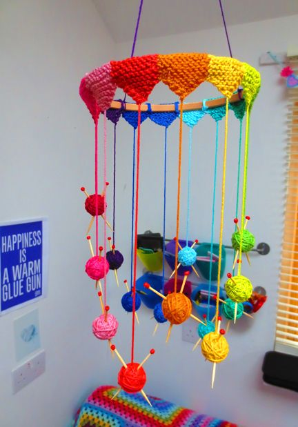 I'm so going to make this for craft room! Also could hang wooden spools with yarn/thread in between the balls/needles.