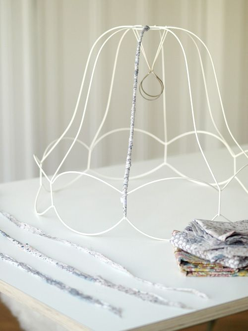 wrap the wire frame of a lampshade, with fabric, with twine, use as a chandelier or a lampshade
