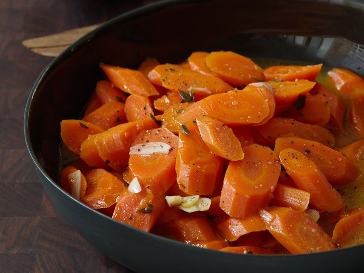Braised Carrots with Thyme   Food & Wine goes way beyond mere eating and drinking. We're on a mission to find the most exciting places, new experiences, emerging trends and sensations.