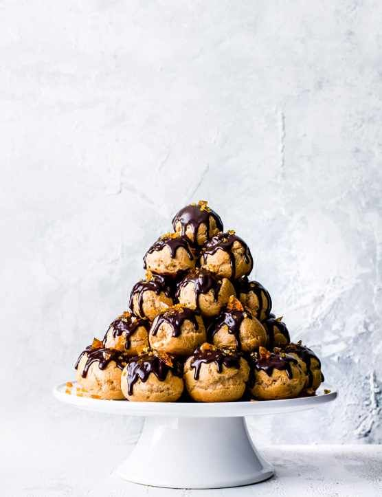 Chocolate and hazelnut profiterole stack Looking for an impressive dessert to serve family and friends? Check out this show-stopping chocolate and hazelnut profiterole stack. With creamy Nutella filling and crunchy hazelnut brittle, this stunning recipe is the perfect end to a dinner party