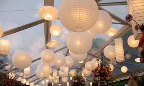 Google Image Result for http://www.freewebs.com/mattandgina/Paper%2520Lantern%2520Canopy%2520White.jpg    Paper lanterns of different sizes- can be used outside or inside.