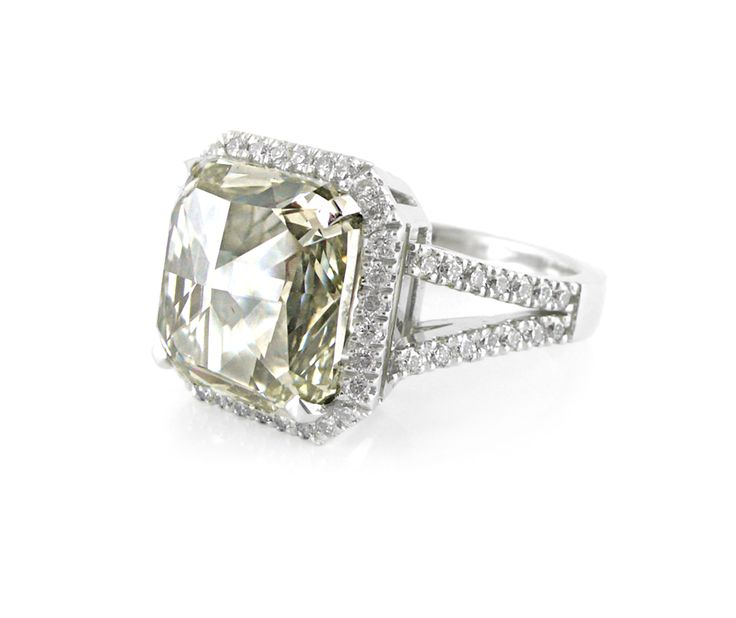 A Platinum and Radiant Cut Diamond Halo Ring