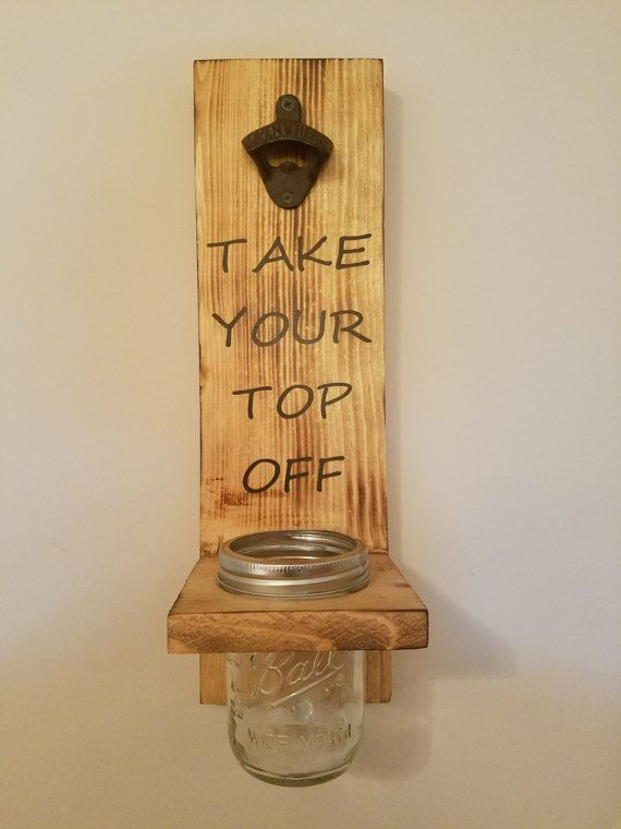 Add a little fun to your home with this wall mounted bottle opener. The mason jar is removable making it easy to empty the bottle caps. It is a great addition to any garage, game room or man cave!  Item pictured is finished with an oak stain and cast iron bottle opener but other stains available as well as a chrome bottle opener.  Want a different saying or logo? This can be customized to your liking! Just include in the note to seller during checkout what you would like yours to say.