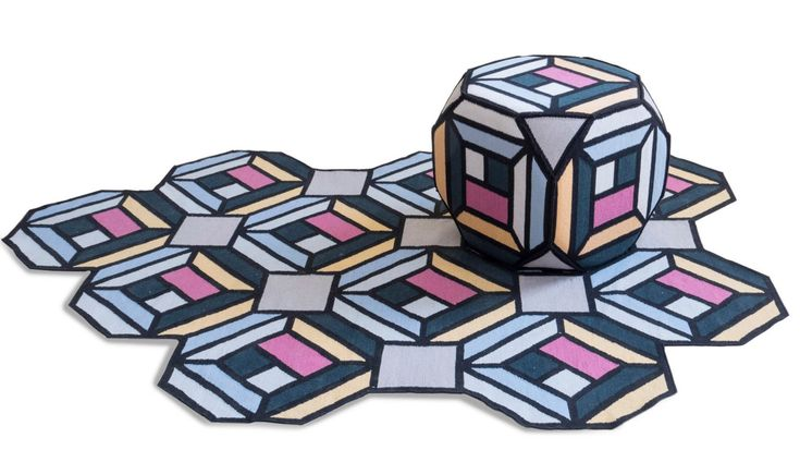 Swedish design studio Front has created a collection of colourful rugs, then transformed the design to produce matching poufs.  Front aimed to replicate the tessellating patterns of parquet flooring with the range, which is being launched by rug brand Gan at IMM Cologne this week.
