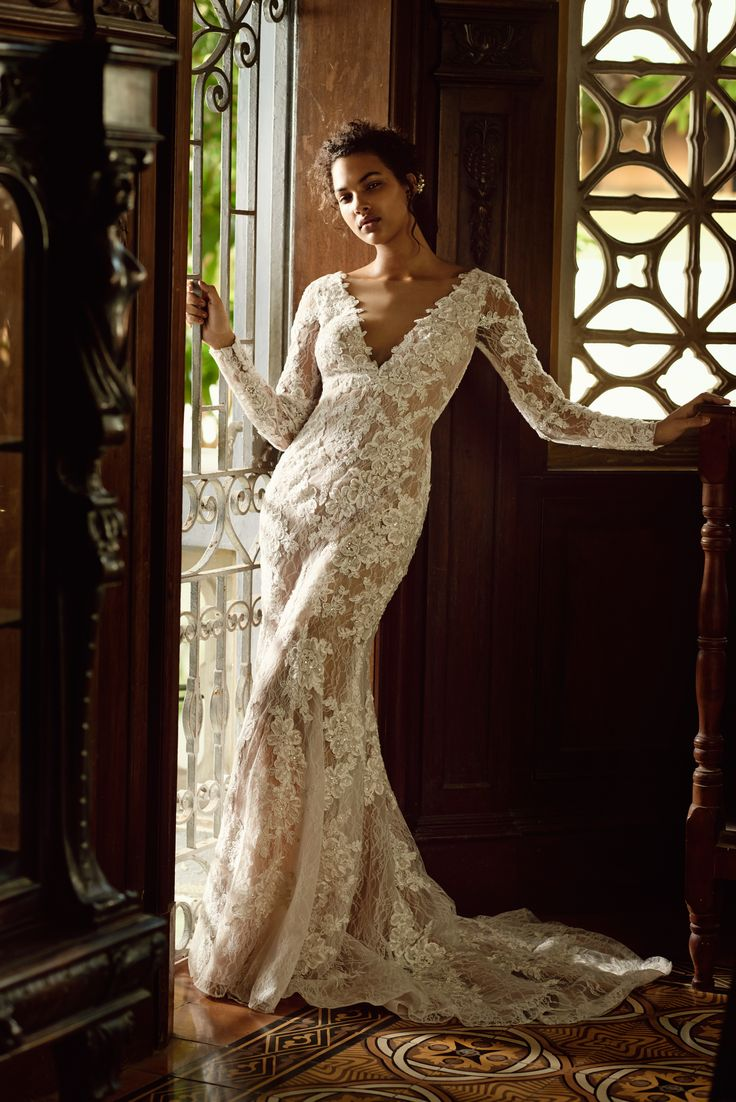 Sultry brides, your dream dress is waiting. Be your most glamorous self in an allover lace sheath from David's Bridal.
