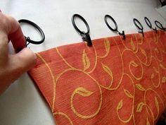 As argolas possuem um clipe de pressão que prende no tecido da cortina