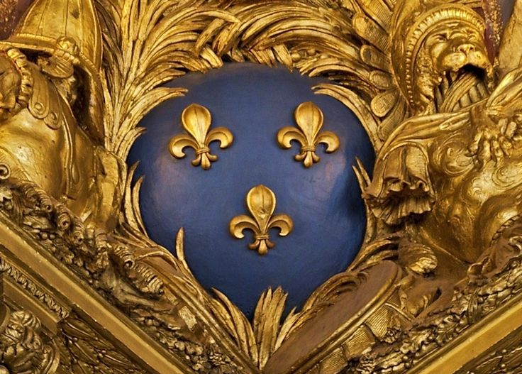 """The French blue and golden """"Fleur de Lis"""" from a ceiling in Versailles. While the fleur-de-lis has appeared on countless European coats of arms and flags over the centuries, it is particularly associated with the French monarchy in a historical context . According to French historian Georges Duby, the three golden petals represent medieval social classes: those who worked, those who fought, and those who prayed."""